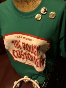 Rough Customers band shirt design on display at their merch table.