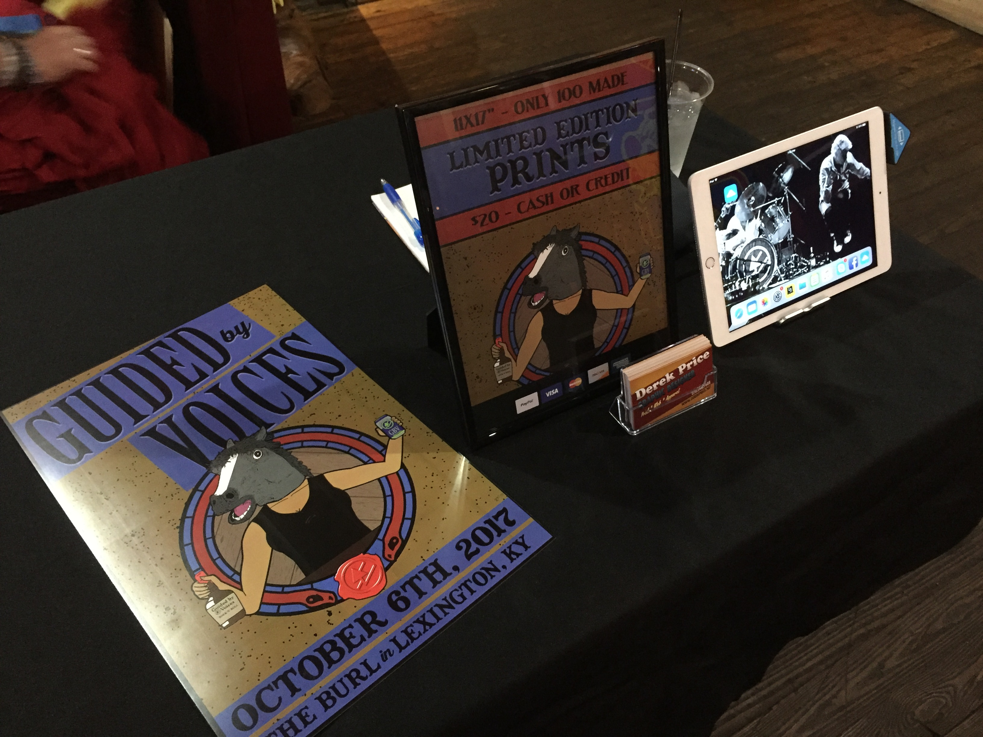 Set up to sell at Guided by Voices' merch table